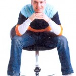 Man sitting in a chair image