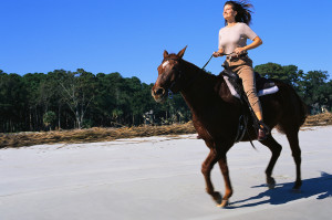 Woman Riding Galloping Horse